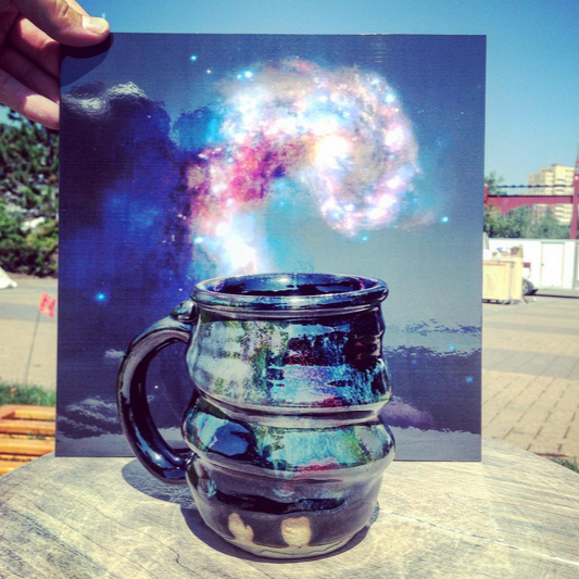 Cosmic Mug Outdoors in front of Galaxy Collision