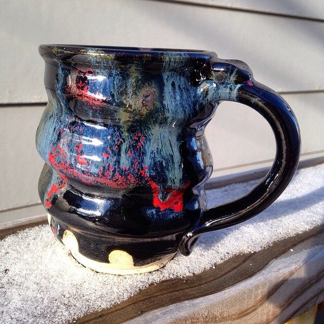 This is how a Cosmic Mug looks in bright sunlight, outdoors in snowy Minnesota.